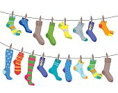 Colorful Fun Socks Set Hang on the Rope for Men and Women. Flat Design Style. Vector illustration