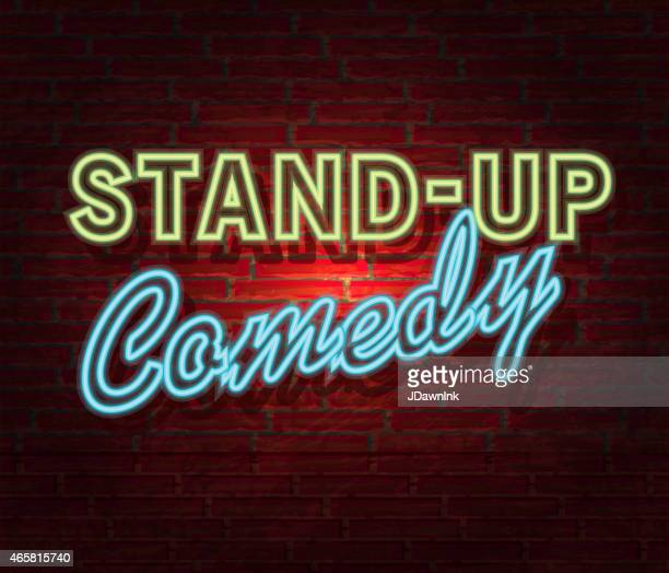 Comedy Night neon sign and brick wall