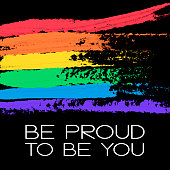 Conceptual poster with LGBT rainbow flag and lettering. White phrase Be Proud To Be You and colorful messy flag isolated on black background. Vector typographic illustration for gay community support