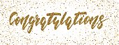 Congratulations - hand drawn lettering, modern brush pen calligraphy with the gold glitter texture on a confetti background.