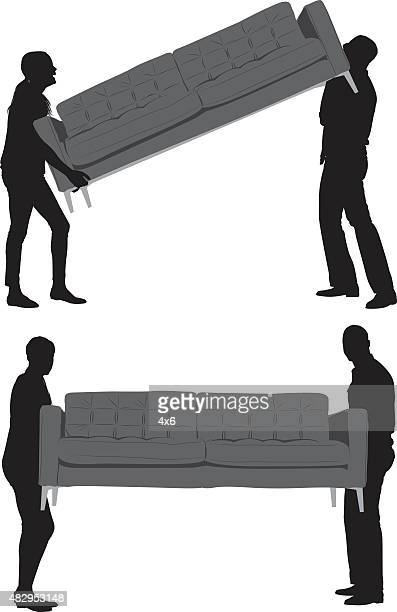 Couple carrying couch