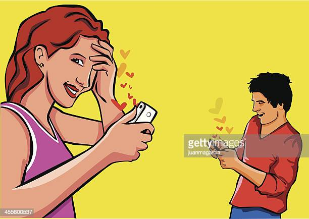 Couple sending messages of love for the smartphone.