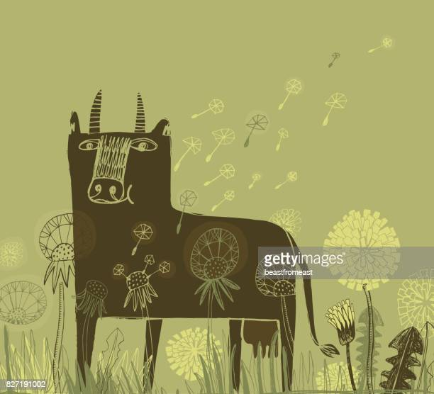 Cow and dandelions