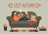 Cozy autumn. woman reading book on sofa at home. Heartwarming family concept. Original vector illustration.