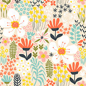 Seamless pattern with abstract hand-drawn flowers and plants on a yellow background in a vector.
