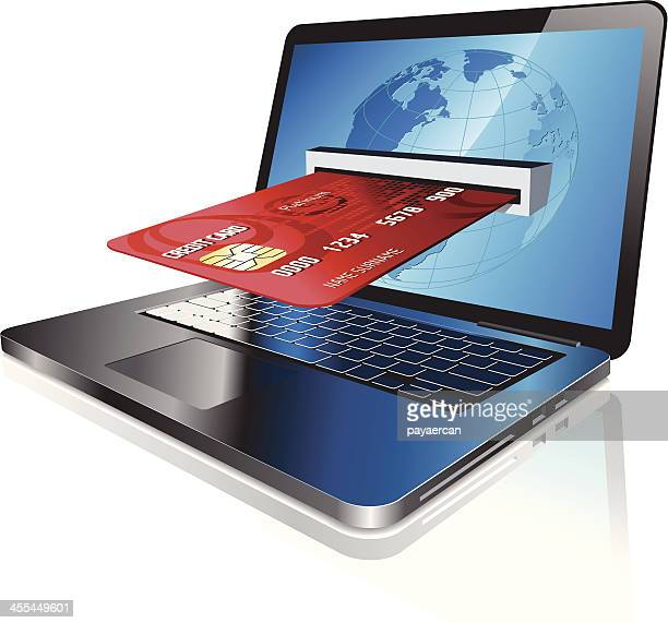 A credit card going into a laptop screen