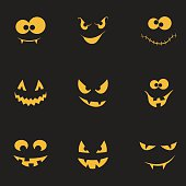 Set of spooky and crazy pumpkins, ghosts and monsters faces in the dark for Halloween design