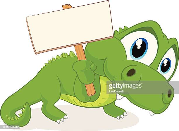 Crocodile holding a blank sign