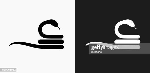 Curled Up Snake Icon on Black and White Vector Backgrounds