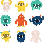 A vector illustration of cute furry monsters set.