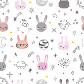 Cute space seamless pattern with cartoon bunnies. Abstract print with animals. Hand drawn nursery background with funny rabbits for little kids. Vector illustration