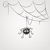 Cute cartoon spider is hanging on the web