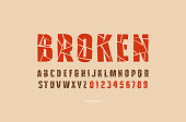 Decorative sans serif font with broken face. Letters and numbers for military, sport, retro emblem and title design. Color typeface on brown background