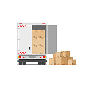 Truck for transportation of goods loaded with cardboard boxes. Delivery truck with a bunch of boxes. The concept of moving to a new house. Vector stock illustration in flat style isolated on white