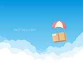 Cardboard with parachute flying down in the sky with white clouds. Delivery concept banner. Text on background. Gift or present box.