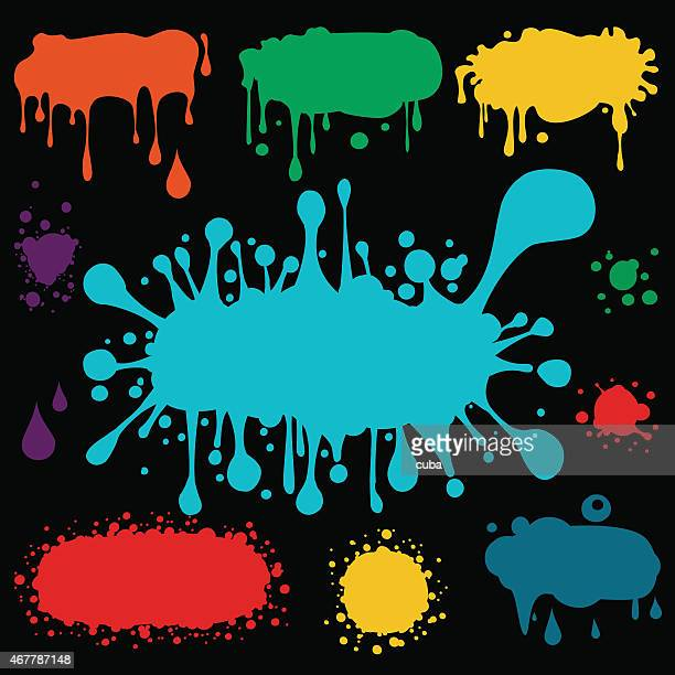 Different colored and size paint blots on black background