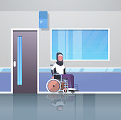 disabled arab woman patient sitting in wheelchair accident disability concept hospital corridor hall modern clinic interior muslim female cartoon character full length flat vector illustration