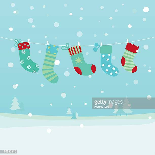 Drawing of Christmas stockings hanging by a laundry line