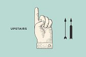 Vintage drawing of hand sign upstairs or hand pointing up in engraving retro style, isolated on color background. Old drawn hand sign upstairs for information sign and navigation. Vector Illustration