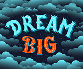 Dream Big. Lettering Motivational poster. Vector illustration with text on dark background with stars and clouds. Blue and orange colors.