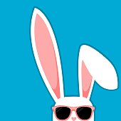 Easter Bunny White Rabbit With Big Ears And Sunglasses On Blue Background
