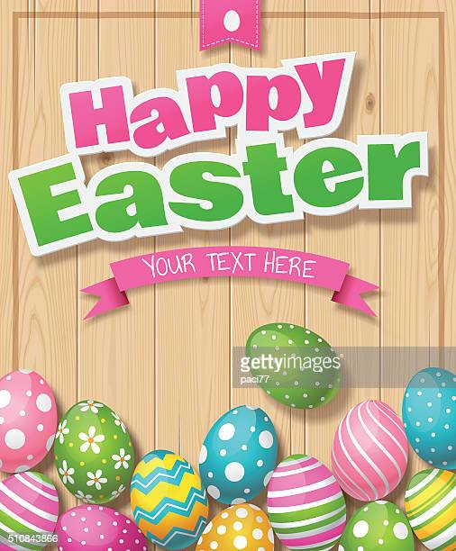 Easter Eggs on Wood background with text 'Happy Easter'