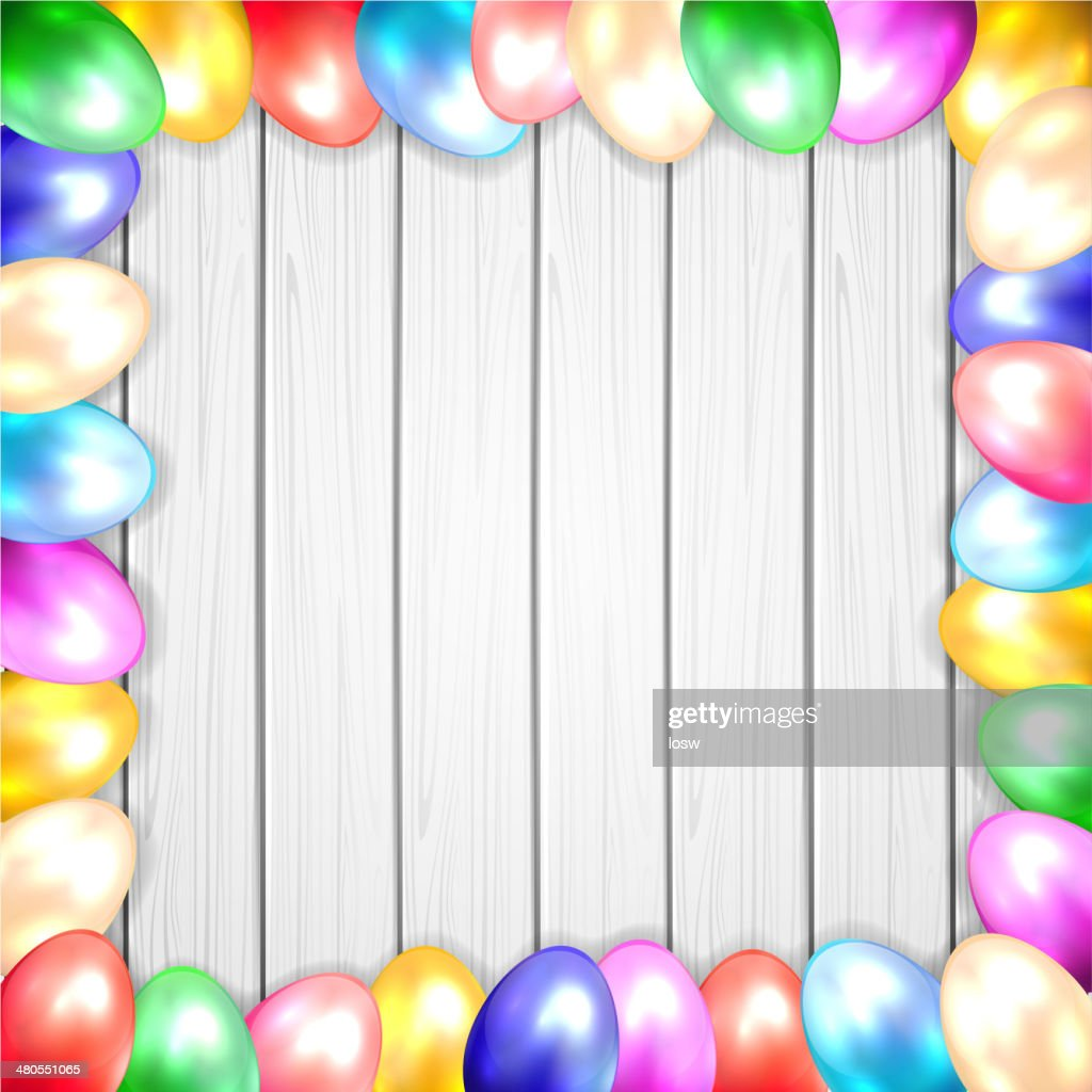 Easter eggs on wooden background : Vector Art