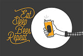 Eat sleep beer repeat typography design and a hand holding a beer can in plaid shirt vector illustration. Cheers mate. Pub or restaurant decoration design. Cold beverage for drunk people