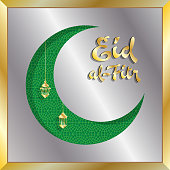 Eid-al-Fitr greeting card with silver and gold crescent moon. All the objects are in different layers and the text types do not need any font.