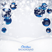 Elegant Christmas background with blue frosted and glossy Christmas balls, stars and snowflakes.
