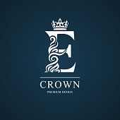 Vector illustration of Elegant letter E with crown. Graceful style. Calligraphic beautiful sign. Vintage drawn emblem for book design, brand name, business card, Restaurant, Boutique, Hotel