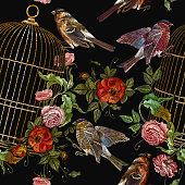Embroidery birds and birds cage and flowers seamless pattern. Classical embroidery bullfinch and titmouse, golden cage, vintage buds of wild roses. Template for design of clothes, t-shirt