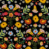 Embroidery ethnic seamless pattern with colorful flowers. Vector traditional floral bouquet. Tribal style design for fashion wearing.
