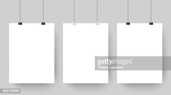 Empty affiche mockup hanging on paper clips. White blank advertising poster template casts shadow on gray background vector illustration : stock vector