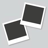 Empty polaroid photo frames in gray background