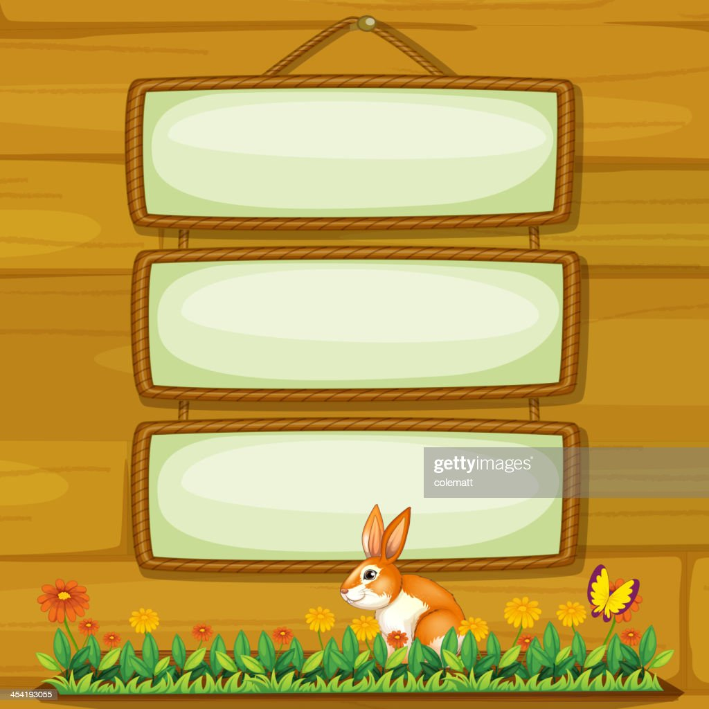 Empty signboard hanging on the wall with a bunny : Vector Art