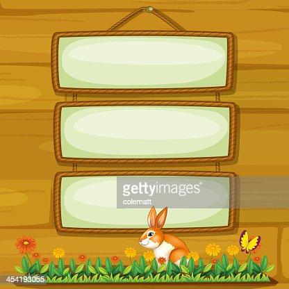 Pintura em branco pendurado na parede com um coelho : Arte vetorial