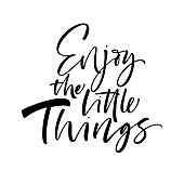 Enjoy the little things phrase. Ink illustration. Modern brush calligraphy. Isolated on white background.