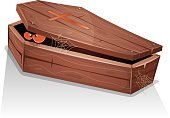Illustration of a cartoon wooden casket with lid open, and eyes of a vampire creature inside