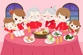 cartoon family wear cheongsam with year dishes in the home