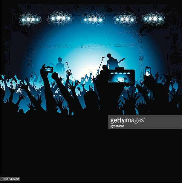 Fans Taking Photos of a Band on Stage