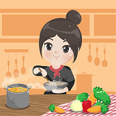 Chef girl is cooking with a happy love in her kitchen.