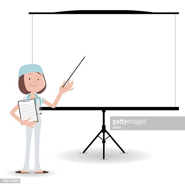female doctor (Surgeon) giving presentation in a conference/meeting setting