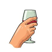 Female hand holding a glass of wine. Vintage vector engraving illustration for label, poster, invitation to a party. Isolated on white background