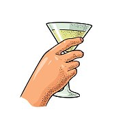 Female hand holding a glass of cocktail. Vintage vector color engraving illustration for label, poster, invitation to a party. Isolated on white background
