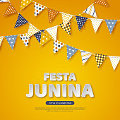 Festa Junina holiday design. Paper cut style letters with bunting flag on yellow background. Template for Brazilian or Latin festival, party. Vector illustration.