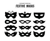 Set of festive vintage carnival masks silhouettes isolated over white. EPS10 vector.