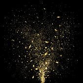 festive gold confetti on a black background