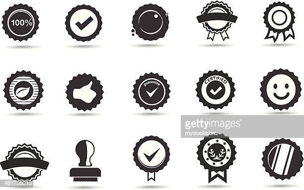 Fünfzehn schwarze und weiße Symbole von Abzeichen und Robben