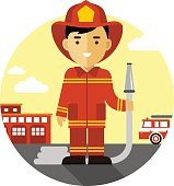 Firefighter in uniform on background with fire truck and fire station